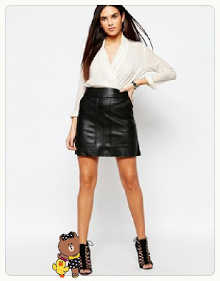 Leather look panelled mini skirt, $63.08 from Warehouse