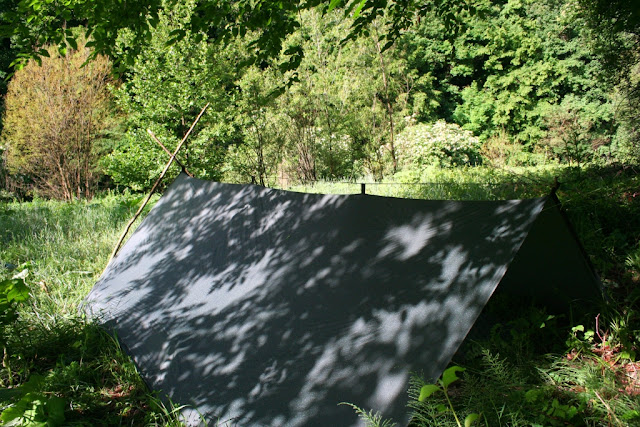 tarp between an A frame and a tree