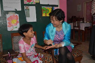 Mrs. Liu Yue, Deputy General Manager of AVIC-INTL Engineering with one of the children at Lawris Girls' Home