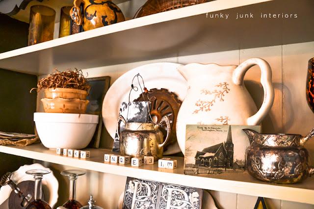 A junk tour of Bella Rustica Linda's house via Funky Junk Interiors - hutch full of cool junk