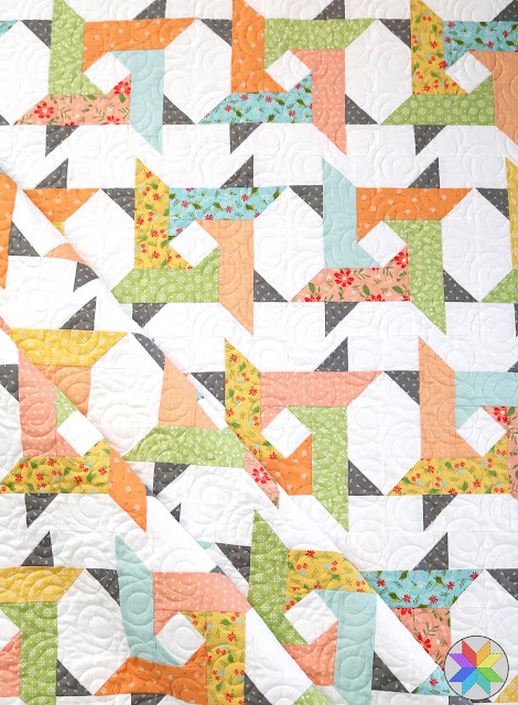 Windy City quilt pattern from A Bright Corner - fun twisted star blocks - a great jelly roll quilt pattern but you can also use layer cake, FQ or yardage too!