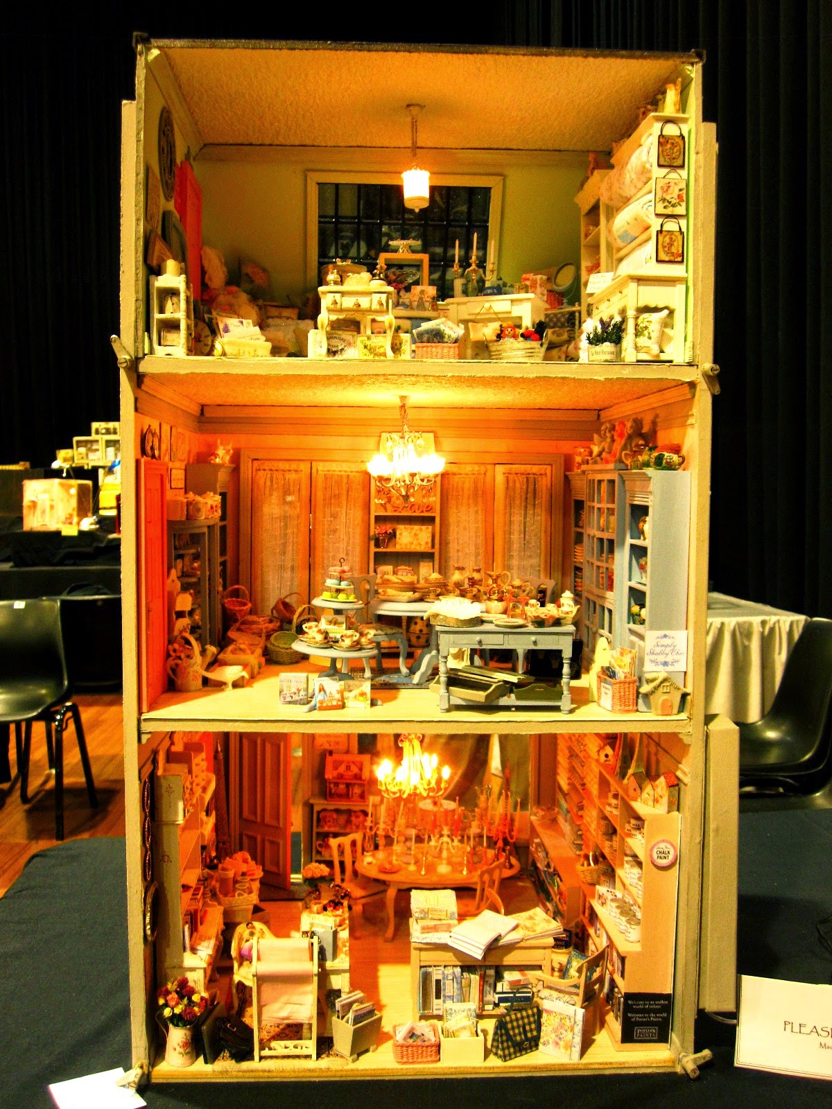 Back view of a modern miniature shabby chic shop, showing three levels of sales areas.