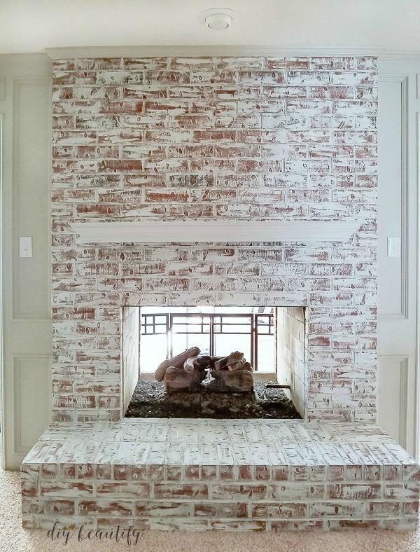 Painted brick fireplace and mantel | diybeautify.com
