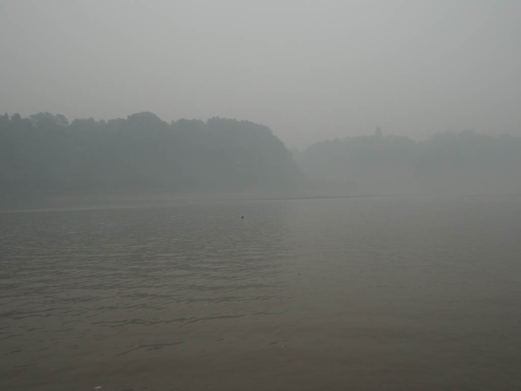 Fog on the river near Giant Buddha of Leshan, China