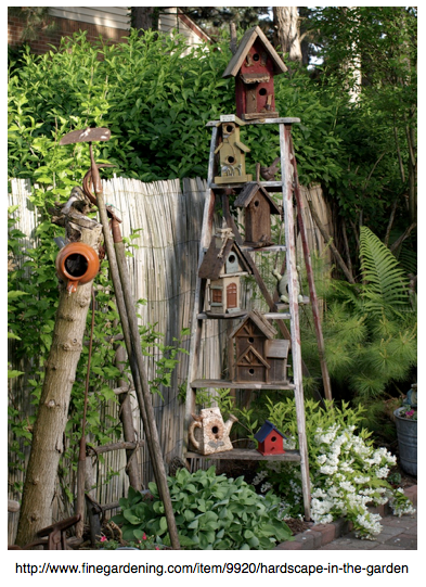 rustic birdhouses on ladder in garden by Fine Gardening.com