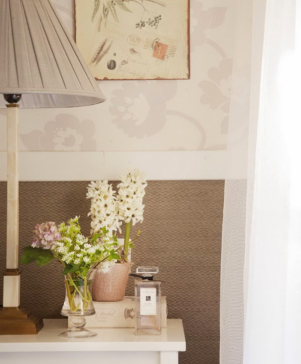 Romantic bedside table vignette. I love the pot of hyacinths and little vase of flowers