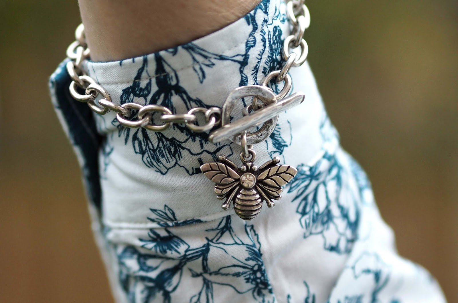 Tulchan floral shirt with skinny jeans and high heeled ankle boots, over 40 style, bee bracelet