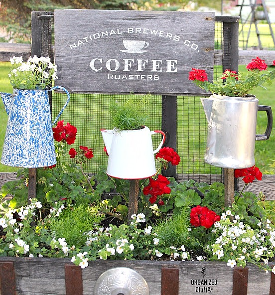 Coffee Sign & Coffeepot Planters on Stakes in the Junk Garden