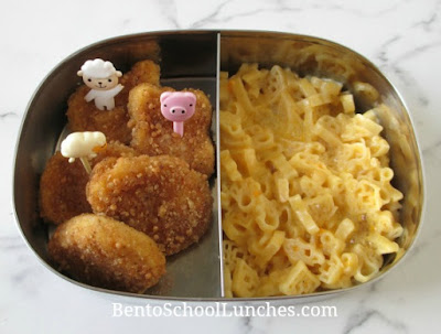 Chicken nuggets with cute picks and macaroni and cheese sent warm for school lunch