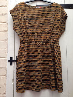 a black, gold, and brone shift dress