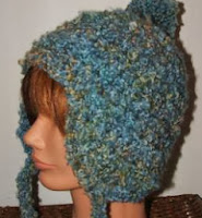 http://translate.googleusercontent.com/translate_c?depth=1&hl=es&rurl=translate.google.es&sl=en&tl=es&u=http://cobblerscabin.wordpress.com/happy-hookin/fun-funky-fluffy-flap-hat-free-crochet-pattern/&usg=ALkJrhjPdjT78g8VLoiOZkDHcZlpunfMKA