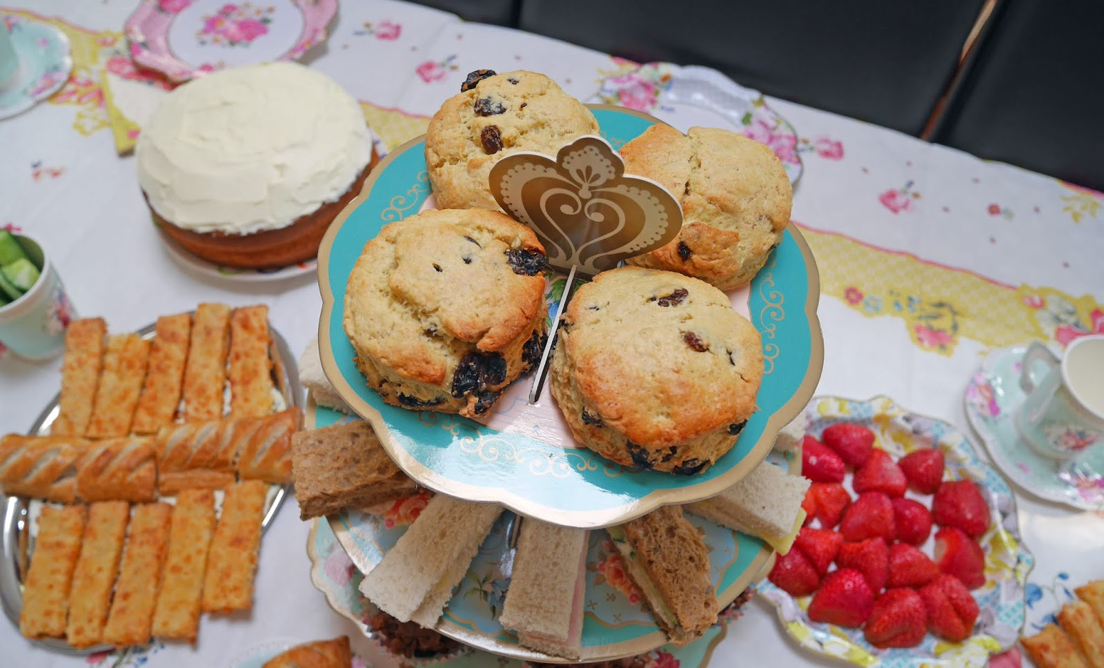 Truly Scrumptious afternoon tea cakestand with scones and sandwiches