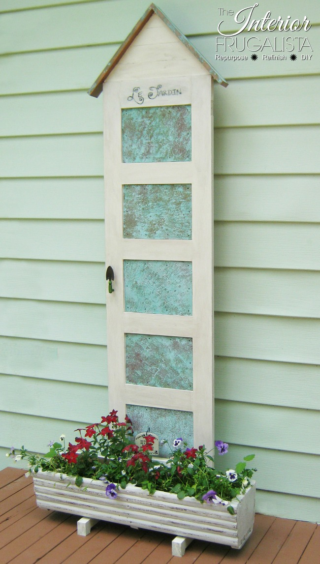 How to repurpose an old 5-panel door into an outdoor flower planter, plus how to make decorative faux oxidized copper tin panels for each door panel.