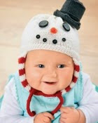 http://www.letsknit.co.uk/free-knitting-patterns/snowman-baby-hat