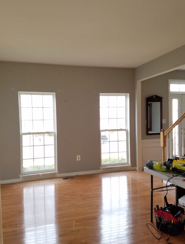 gray room with two plain windows