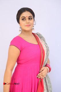 Actress Poorna Pictures in Red Salwar Kameez at Jayammu Nischayammu Raa Teaser Launch  0017