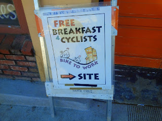 Sign reads 'Free Breakfast 4 Cyclists'