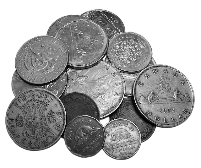 Coins in various currencies, including half dollars and nickels.