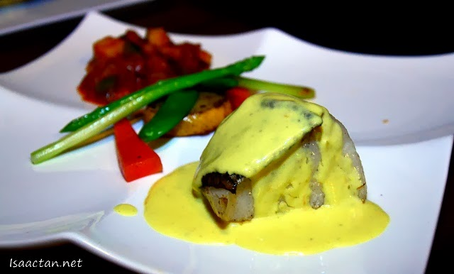 The Pan Seared Atlantic White Cod Fillet with Vegetables and Ratatouille Saffron Foam Reduction