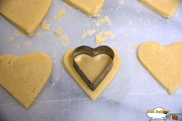 cutting cookies with heart cookie cutter