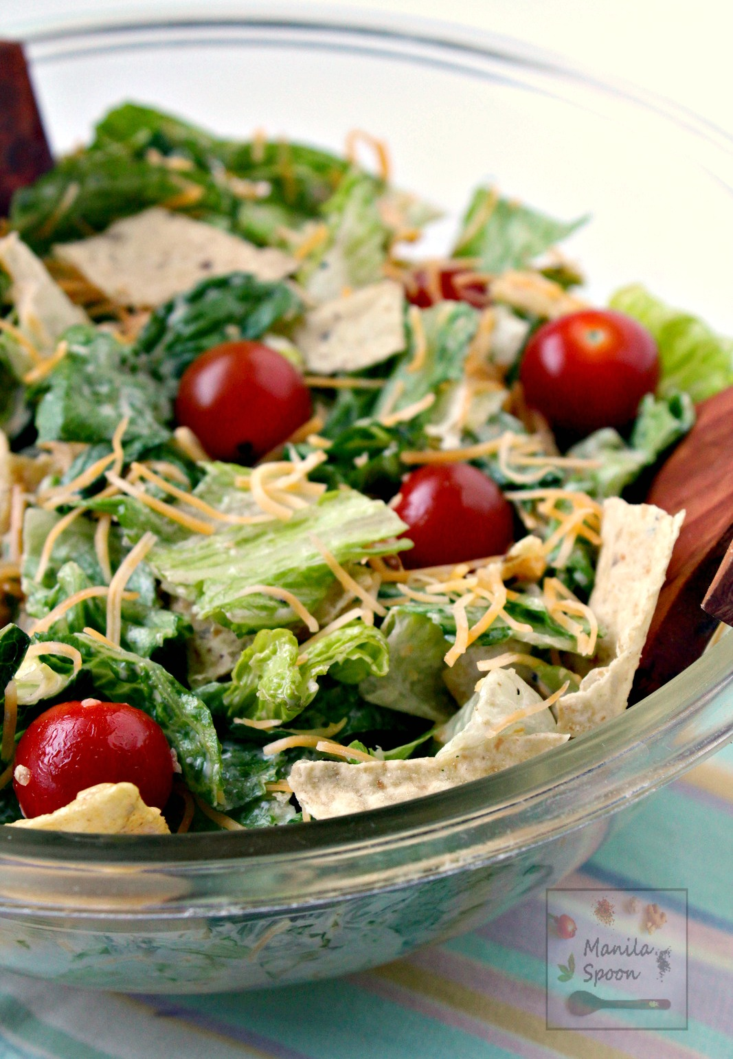 Crunchy tortillas and cumin-flavored dressing give this southwestern-style salad its delicious flavor! With few ingredients and just 5 minutes to make - it's a winner every time! | manilaspoon.com