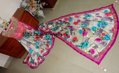 Glitz by swarnagiri - Floral saree with glittering blouse