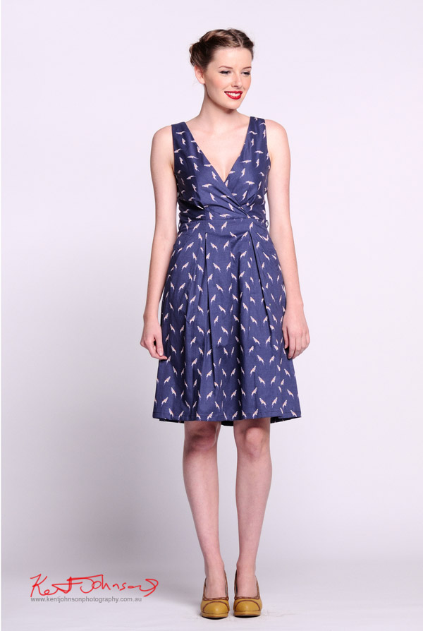 Blue wrap style 40's dress with white bird pattern , full length shot - Vintage Fashion - Studio White Background -