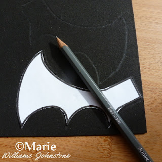 Wing template, pencil and black craft foam