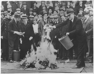 Crowds gather as hundreds of thousands of dollars in 'Scrip Money' are burned. The notes were issued after the bank had closed. April, 1933. Local Identifier: 306-NT-177.567C - Source: http://unwritten-record.blogs.archives.gov/page/8/