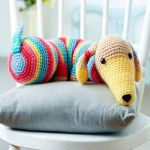 http://www.topcrochetpatterns.com/images/uploads/pattern/Frank_the_doggie.pdf