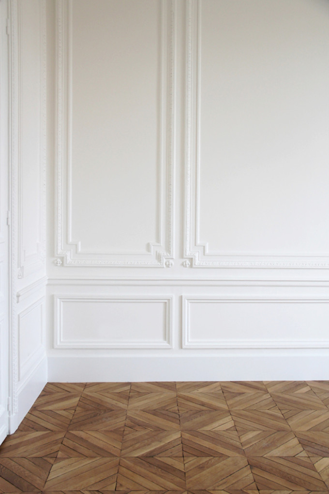 herringbone wood floors and white crown molding