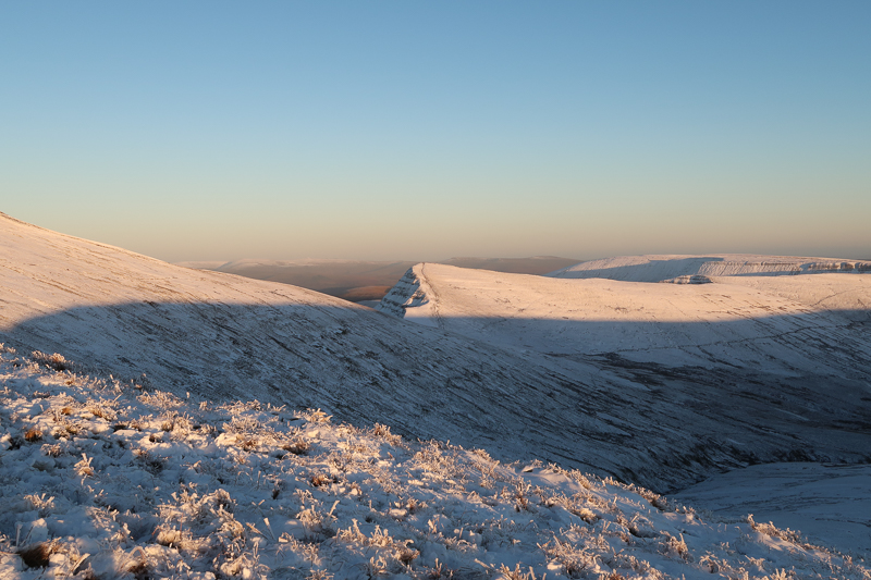 pen y fan at sunset in the snow