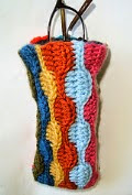 http://translate.google.es/translate?hl=es&sl=en&tl=es&u=http%3A%2F%2Fknotbygranmablog.blogspot.com.es%2F2009%2F08%2Ffree-crochet-pattern-scrap-yarn.html%23.U2K0A6J7Q1Y