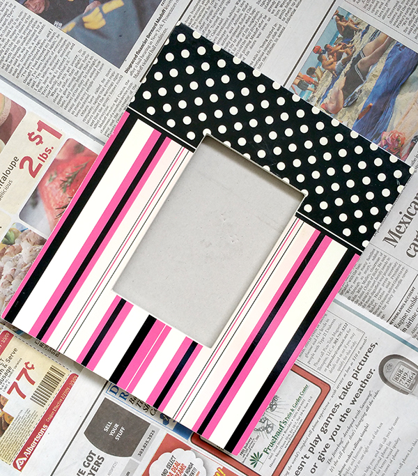 picture with white dots and pink, black white stripes