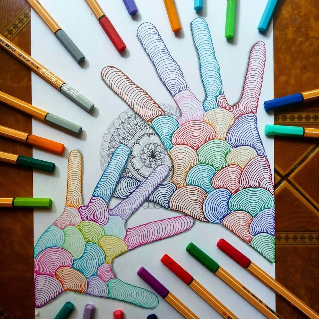 06-Hands-lady-meli-art-Precision-in-Geometric-Mandala-Drawings-www-designstack-co