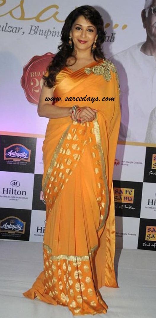 Latest saree designs madhuri dixit in orange crepe saree checkout bollywood actress madhuri dixit in orange crepe saree with zari pola dots and zari border and paired with matching blouse altavistaventures Image collections
