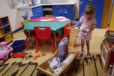 Jessica with her trolley in the playroom