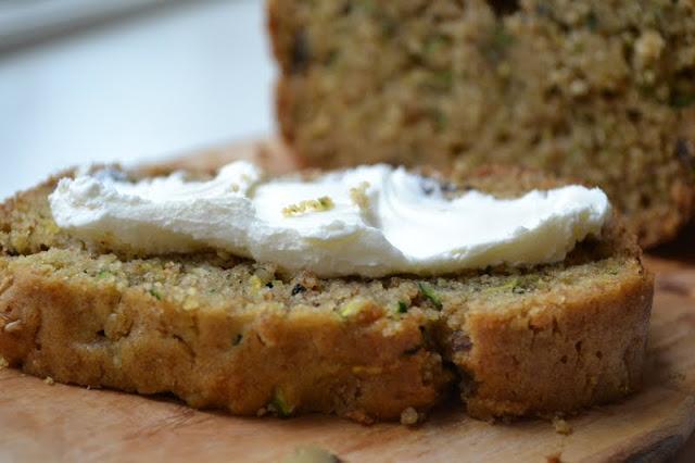 A slice of classic zucchini bread with cream cheese