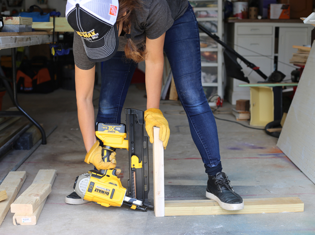 Cristina Garay driving nails with DeWalt cordless framing nailer