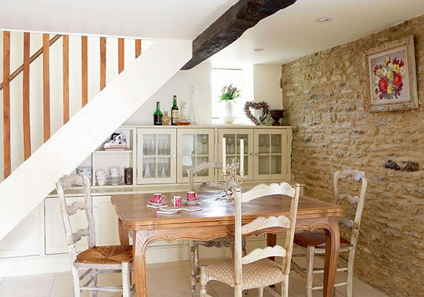 Country cottage dining room with under stairs storage for crockery and tableware