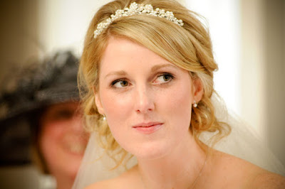 Blonde bride with soft side swept wedding hair