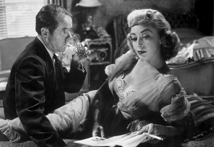 Marie Windsor's Sherry manipulates Elisha Cook Jr. in The Killing.