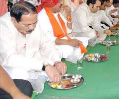 Standing Eating at party