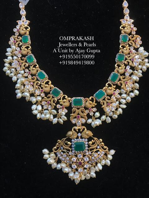 Emerald Guttapusalu by Omprakash Jewellers