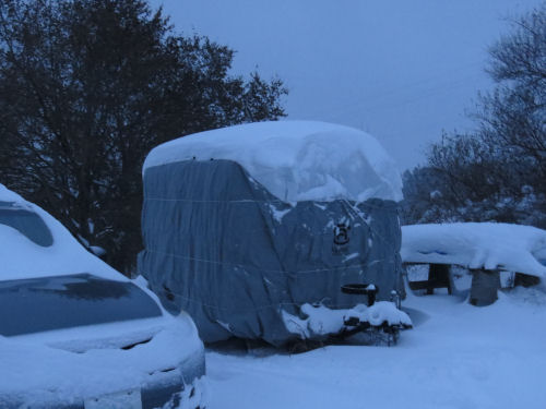 small trailer covered for the winter