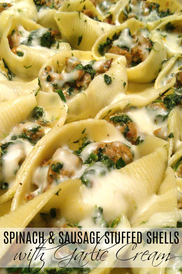 Sausage and Spinach Stuffed Shells with Garlic Cream Sauce | A rustic, simple recipe for stuffed pasta shells with Italian sausage, spinach and mozzarella topped with an easy garlic cream sauce.