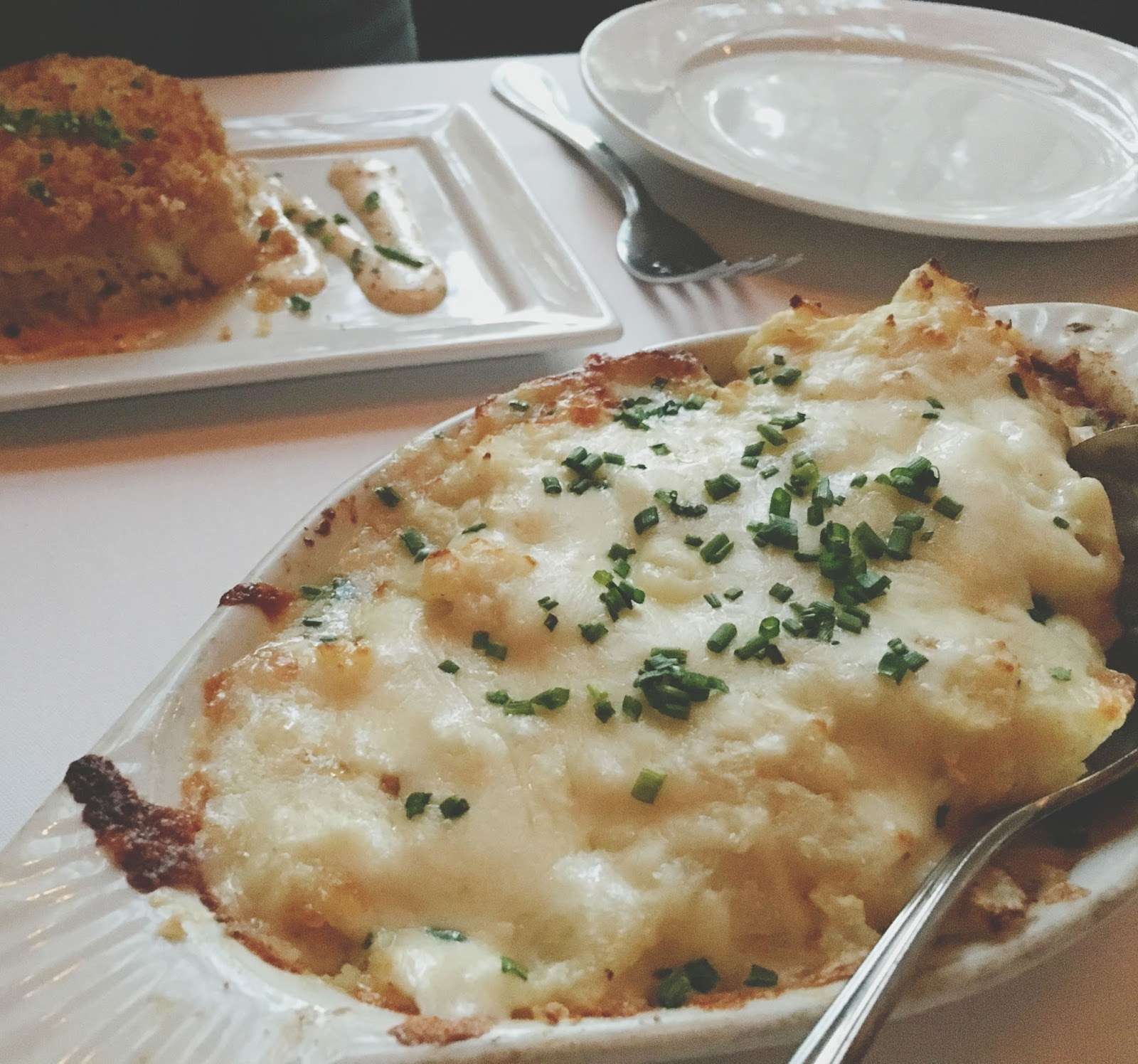 potatoes au gratin at Eddie V's - A restaurant in Houston, Texas
