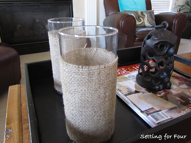 See this Quick and Easy way to dress up your hurricane candle holders with burlap! DIY Burlap Hurricane Sleeve with easy tutorial and supply list included.