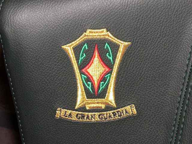 La Gran Guardia logo, upholstery of the seats of the new theaters, Livorno