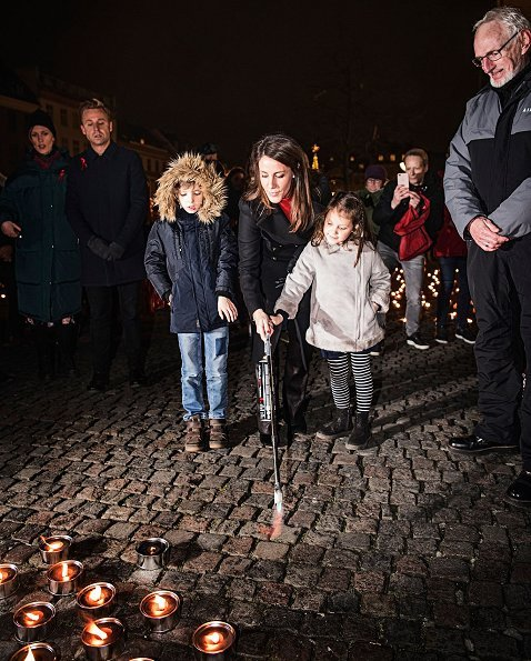 Princess Marie of Denmark, together with her children Prince Henrik and Princess Athena at Gammeltorv square